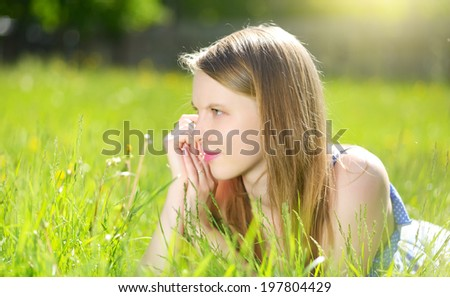 Beautiful young girl outdoor. light background
