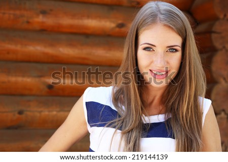 Beautiful young girl outdoors - stock photo