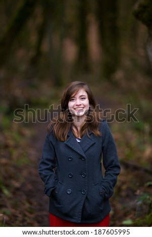 Beautiful young girl outdoors in the winter in this trendy fashion portrait.