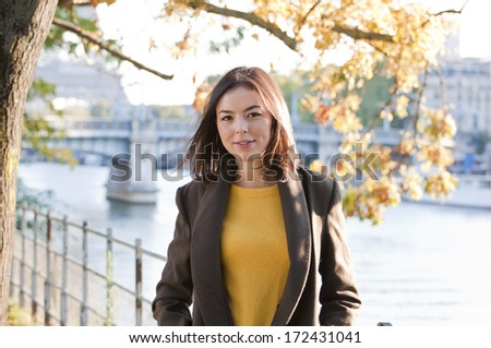 Beautiful young girl outside on a sunny spring day - stock photo