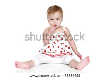 Beautiful young girl play on a white background