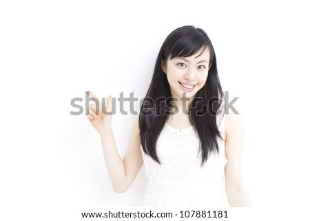 beautiful young girl pointing copy space