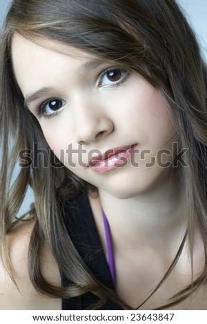 Beautiful young girl portrait studio - stock photo