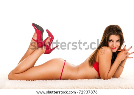 Beautiful young girl posing in a sexy  red underwear - stock photo