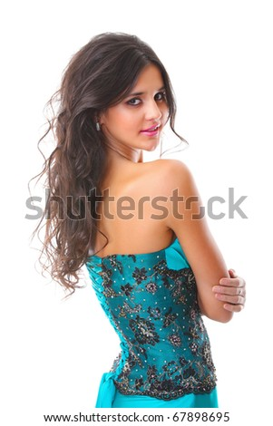 Beautiful young girl posing in blue fashionable dress on white background