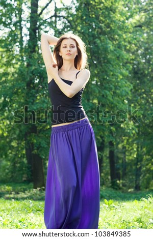 Beautiful young girl posing in the park - stock photo