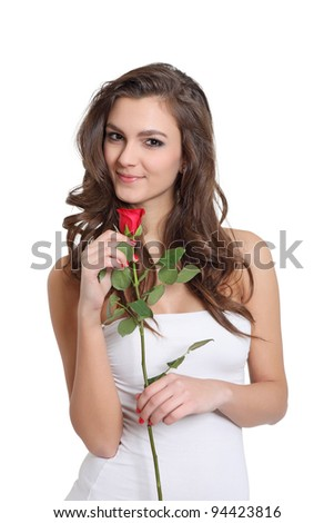 Beautiful young girl posing with a rose - stock photo
