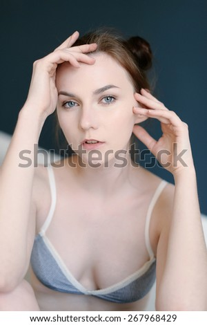 Beautiful young girl posing with hands  - stock photo