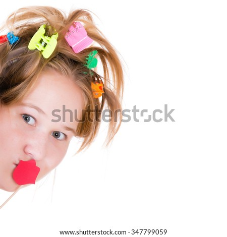 Beautiful young girl posing with red lips props. - stock photo