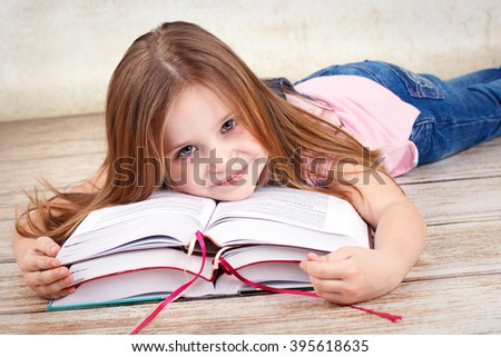 Beautiful young girl reading book - stock photo