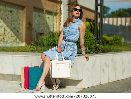 Beautiful young girl shopping in the big city - stock photo