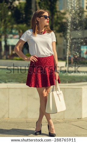 Beautiful young girl shopping in the big city - stock photo