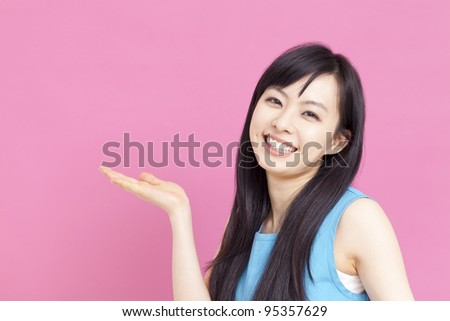 beautiful young girl showing - stock photo