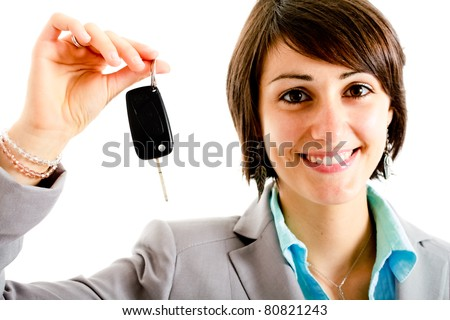 Beautiful young girl showing a key. Focus on hand. Isolated on white. - stock photo