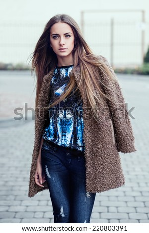 beautiful young girl showing fashionable clothes - stock photo
