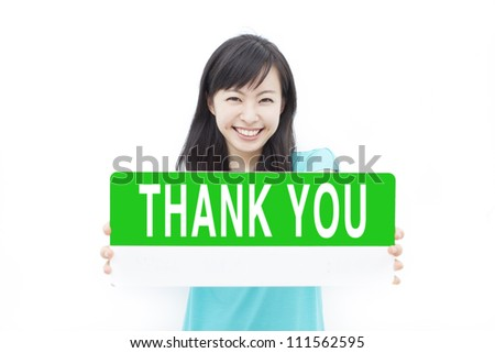 """beautiful young girl showing """"THANK YOU"""" sign, isolated on white background - stock photo"""
