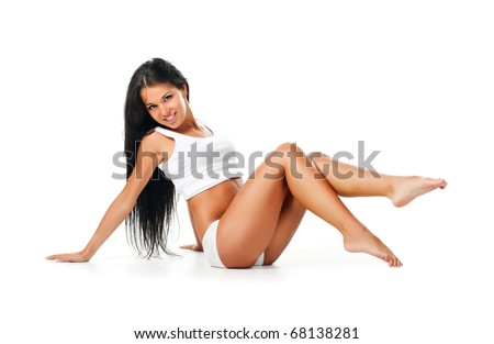 Beautiful young girl sit. Isolaed on a white background