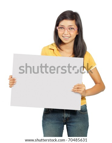 Beautiful young girl smiling holding big blank card - stock photo