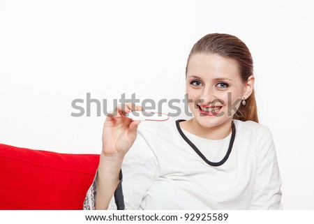 beautiful young girl smiling , showing the pregnancy test - stock photo
