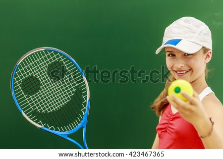 Beautiful young girl tennis player - stock photo