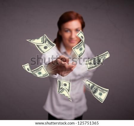 Beautiful young girl throwing money - stock photo