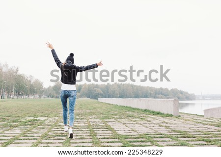 Beautiful young girl walking and having fun. Outdoor lifestyle portrait of woman - stock photo