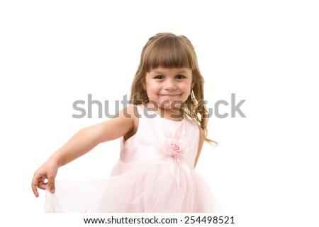 beautiful young girl wearing a fancy pink dress, isolated on white
