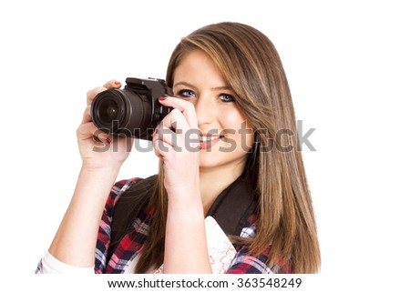beautiful young girl with a camera and map isolated on white
