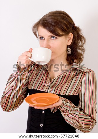 beautiful young girl with a cup of tea in hand - stock photo
