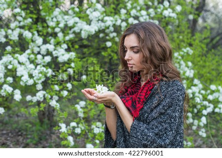 beautiful young girl with a flower