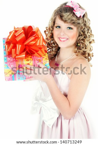 Beautiful young girl with a gift box - stock photo