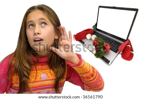 Beautiful young girl with a laptop in christmas time isolated against a white background