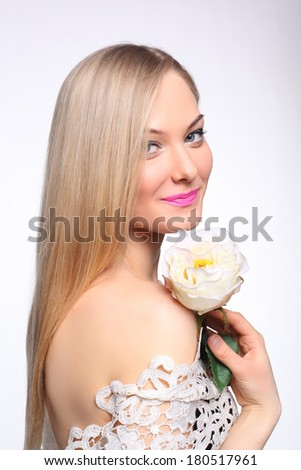 beautiful young girl with a white rose