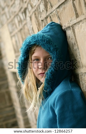 Beautiful young girl with blue sweater. - stock photo