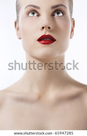Beautiful young girl with bluel eyes and red lips