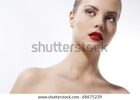 Beautiful young girl with bluel eyes and red lips - stock photo