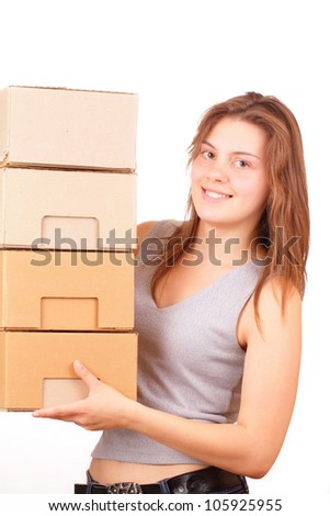 Beautiful young girl with cardboard boxes - stock photo