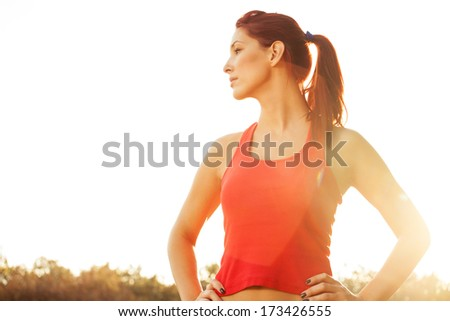 beautiful young girl with concetrate facial expression.Fitness training concept.  - stock photo