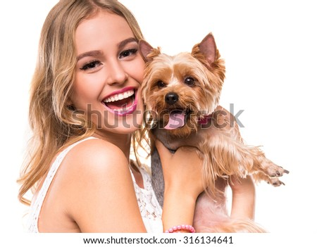 Beautiful young girl with cute yorkshire terrier dog, isolated on white. - stock photo
