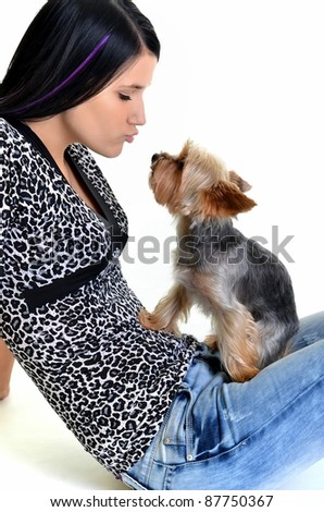 Beautiful young girl with cute yorkshire terrier dog, isolated on white.