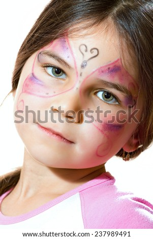 Beautiful young girl with face painted - stock photo