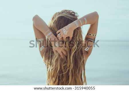 Beautiful young girl with Flash Tattoo  - stock photo