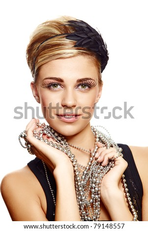 beautiful young girl with fresh make-up wearing vintage feather hair accessories and silver necklace, naturally beautiful skin texture. - stock photo