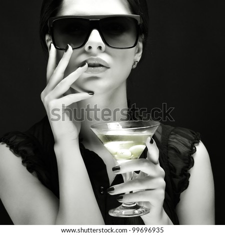 beautiful young girl  with  glass of martini - stock photo