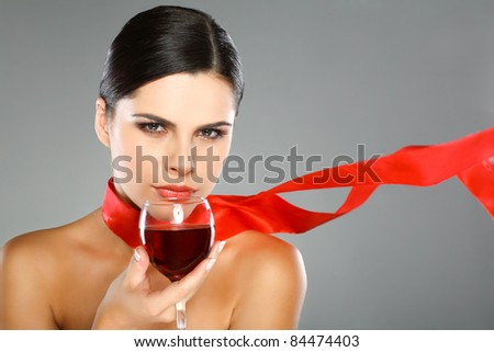 beautiful young girl  with  glass of wine - stock photo