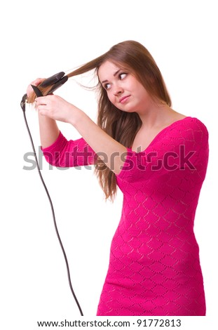 Beautiful young girl with hair dryer on white background.