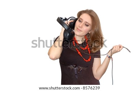Beautiful young girl with headphones isolated over a white background - stock photo