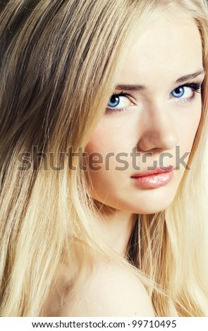 Beautiful young girl with healthy skin and long white hair - stock photo