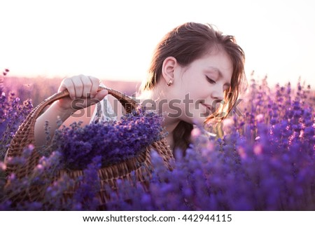 Beautiful young girl with lavender flowers, smiling girl in lavender field enjoy nature, France woman in provence health care and aromatherapy concept.soft focus