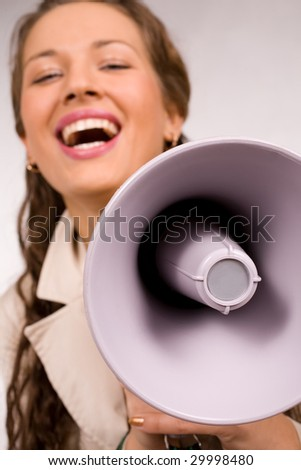 Beautiful young girl with megaphone - stock photo